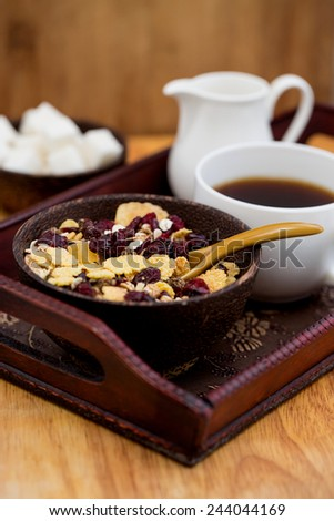 A cup of coffee, sugar, cream, muesli. Still life - stock photo