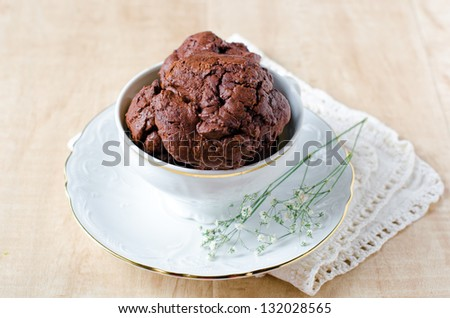 A Cup of coffee with chocolate biscuits - stock photo