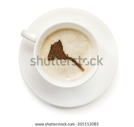 A cup of coffee with foam and powder in the shape of Eritrea.(series) - stock photo