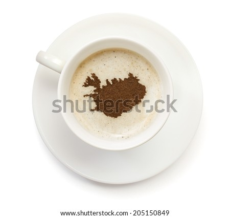 A cup of coffee with foam and powder in the shape of Iceland.(series) - stock photo