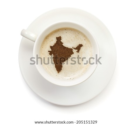 A cup of coffee with foam and powder in the shape of India.(series) - stock photo