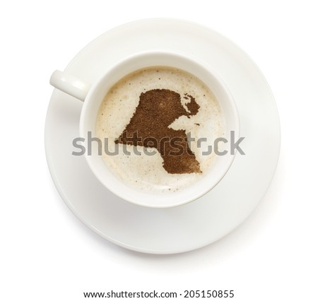 A cup of coffee with foam and powder in the shape of Kuwait.(series) - stock photo