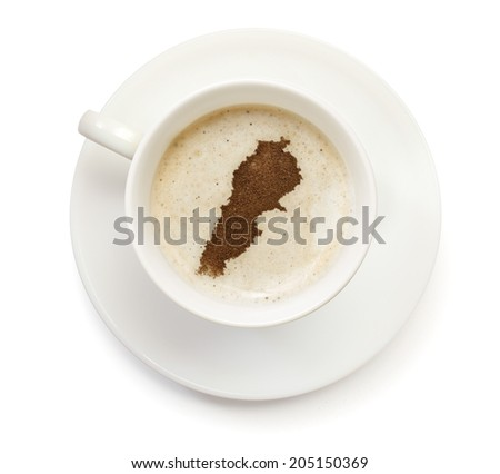 A cup of coffee with foam and powder in the shape of Lebanon.(series) - stock photo