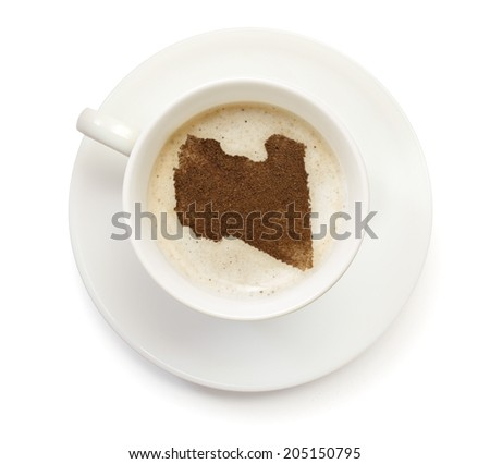 A cup of coffee with foam and powder in the shape of Libya.(series) - stock photo