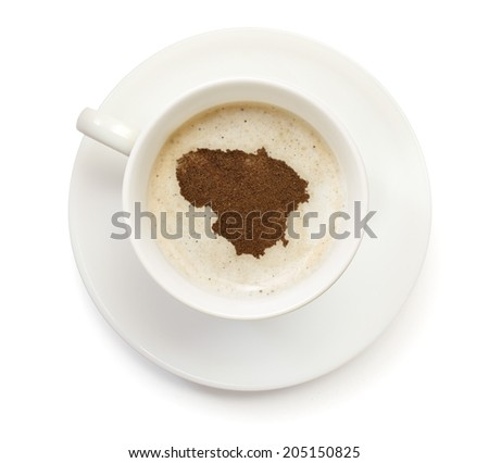 A cup of coffee with foam and powder in the shape of Lithuania.(series) - stock photo