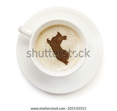 A cup of coffee with foam and powder in the shape of Peru.(series) - stock photo