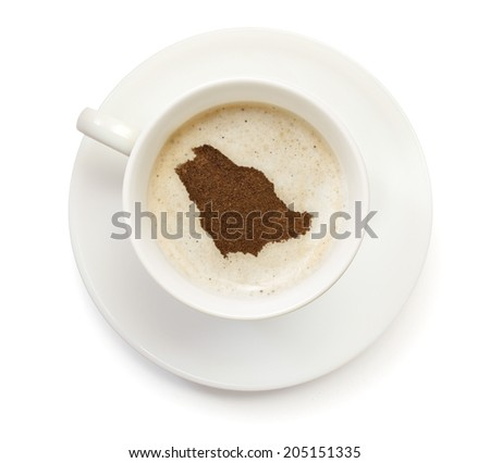 A cup of coffee with foam and powder in the shape of Saudi Arabia.(series) - stock photo