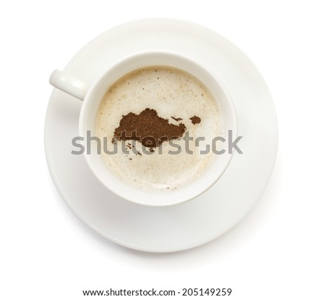 A cup of coffee with foam and powder in the shape of Singapore.(series) - stock photo