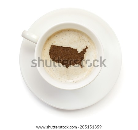 A cup of coffee with foam and powder in the shape of USA.(series) - stock photo