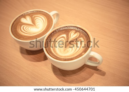 A cup of coffee with heart latte art on top - stock photo