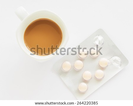 A cup of coffee with medicine - stock photo