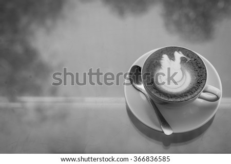 A Cup of Coffee with spoon.
