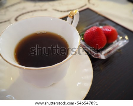 A Cup of Coffee with Strawberries