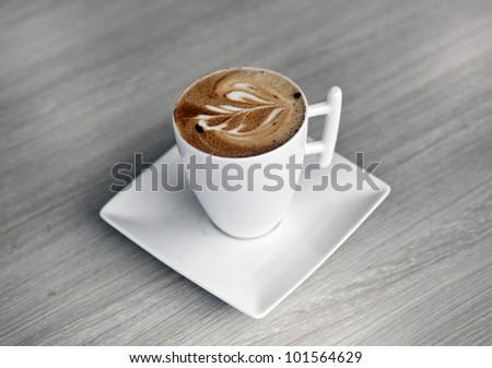 a cup of fine coffee with art - stock photo