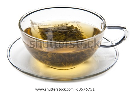 A cup of green tea with tea bag, on white background