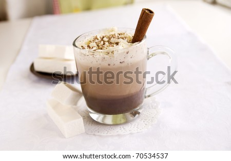 A cup of hot chocolate with marshmallow, close up - stock photo