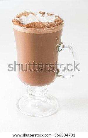 A cup of hot cocoa with marshmallows on the top.