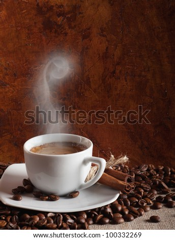 a cup of hot coffee and steam