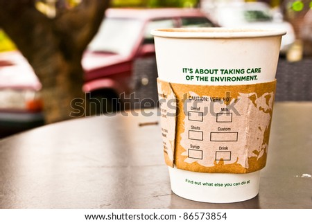 a cup of hot coffee in paper cup for the environment, no visible trademarks