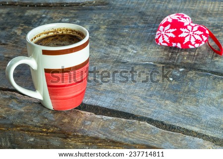 A cup of hot coffee on rustic wooden table, close-up - stock photo