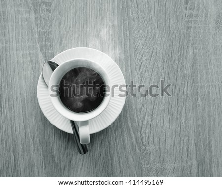 A cup of hot coffee with space -black and white.