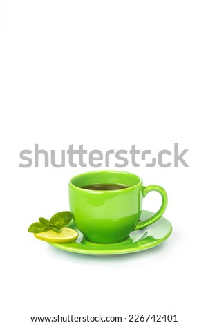 A cup of hot tea with lemon and mint isolated on a white background - stock photo