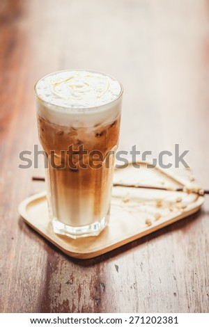 A cup of ice coffee with instagram vintage filter effect, selective focusing. - stock photo