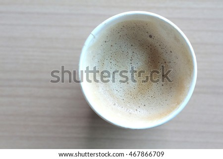 A cup of Latte inside Paper Cup