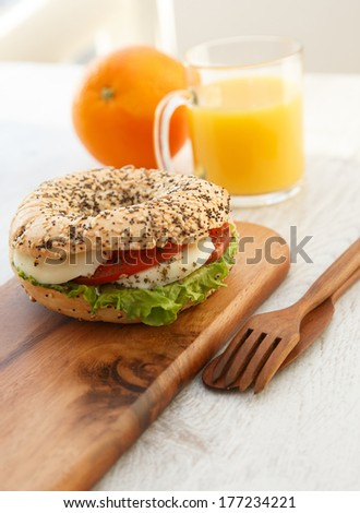 A cup of orange juice and a healthy sandwich - stock photo