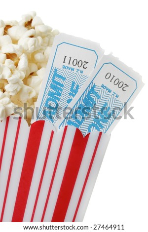 A cup of popcorn and two movie tickets, isolated on a white background. - stock photo