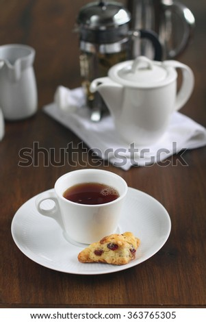 a cup of tea  and a cranberry scone