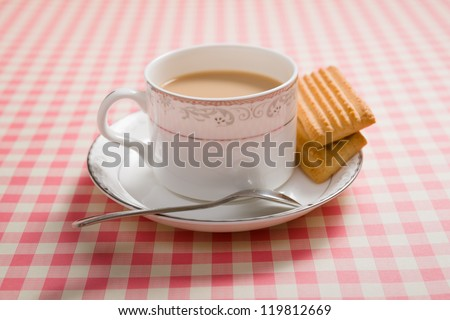 a cup of tea on a table - stock photo