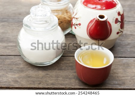 a cup of tea on wood background - stock photo