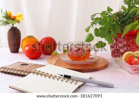 A cup of tea with fruits - stock photo