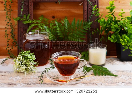 A cup of tea with pot - stock photo