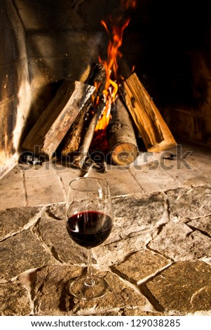 A cup of wine with fire on the background, romantic meal. Love. Write your own message. - stock photo