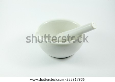 a cup-shaped receptacle made of hard material, in which ingredients are crushed or ground, used especially in cooking or pharmacy.