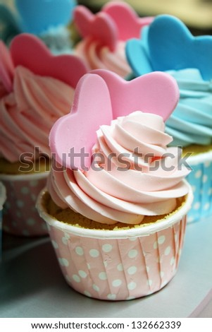 A Cupcake decorated with an embossed sugar heart