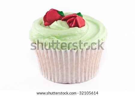 A cupcake with sugar roses on top isolated on white