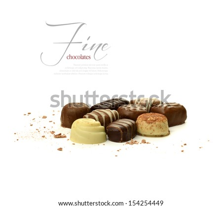 A curated image from my FINE series set. Image of various delicious chocolates against a white background. The perfect image for a Valentines or mother's day design. Copy space. - stock photo