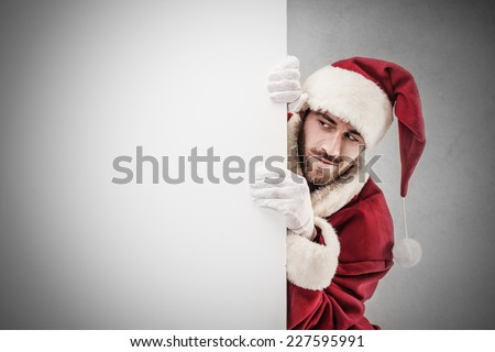 A curious Santa Claus  - stock photo