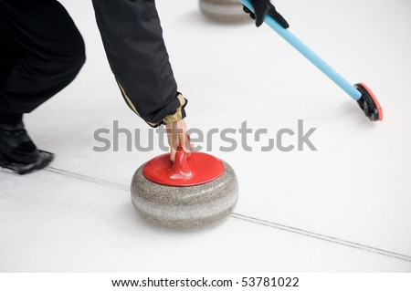 A curler starts launch a stone - stock photo