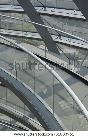 A curved footbrige in a building hall. Picture taken in Berlin