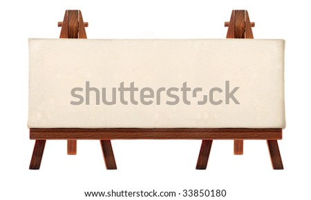 a customizable blank canvas on a wooden big tripod - stock photo