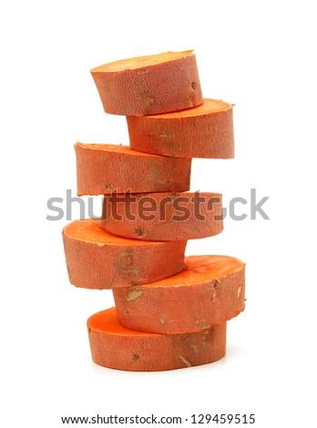 a cut sweet potato on a white background - stock photo