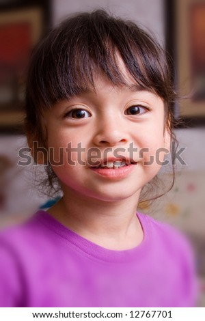 A cute and adorable little girl in smiling.