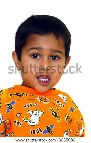 A cute anxious indian kid looking eagerly - stock photo
