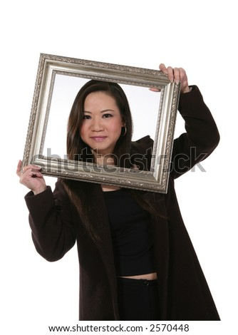 A cute asian girl holding a picture frame around her face