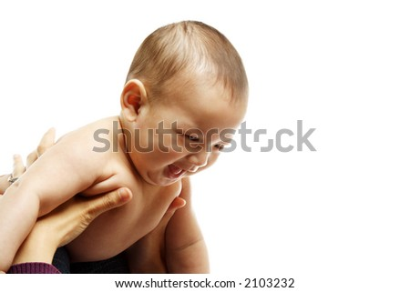 A cute baby boy feeling happy playing with his mom - stock photo