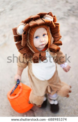A cute baby child is holding a candy bag while dressed up in a lion  sc 1 st  Shutterstock & Cute Baby Child Holding Candy Bag Stock Photo (Royalty Free ...